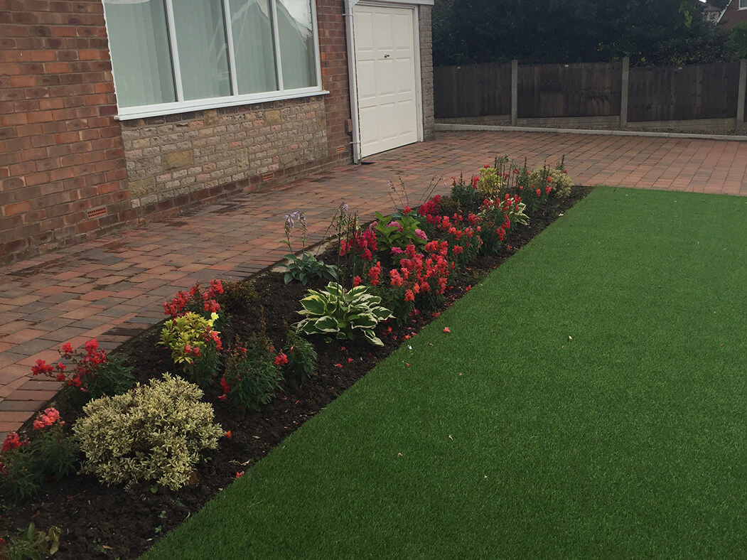 artificial lawn in front garden of house in lancaster