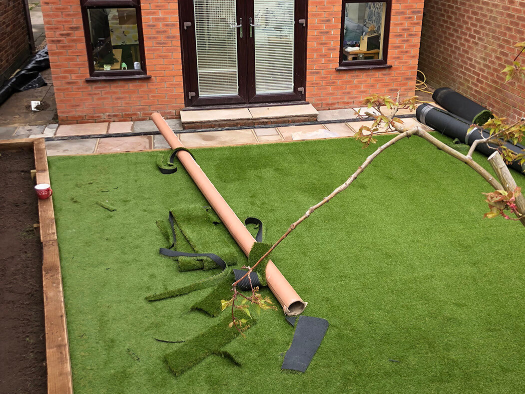 artificial lawn being completed in lancashire