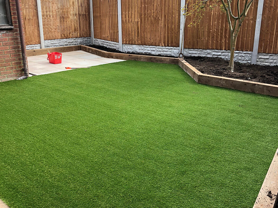 wide view of artificial lawn and landscaping work done in lancashire
