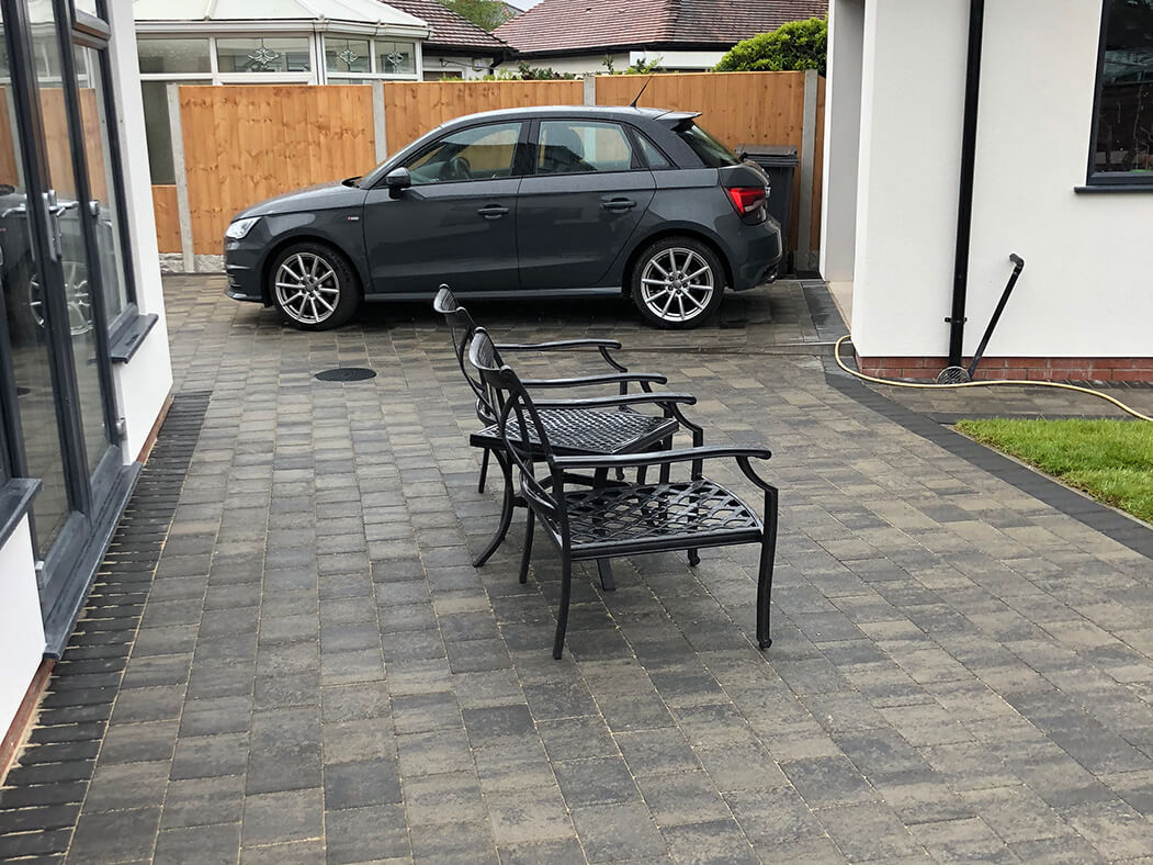 Block Paving Driveway with car and chairs in Morecambe, Lancashire