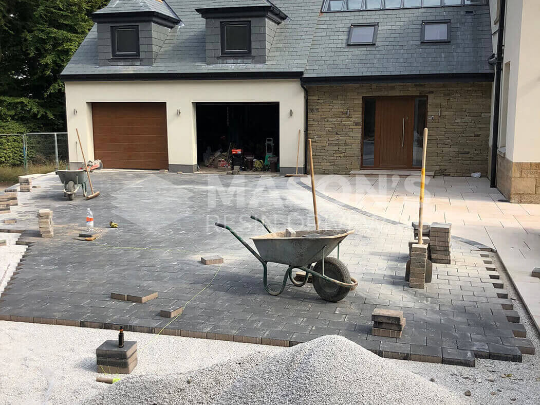 Starting to lay block paving driveway in Lancaster