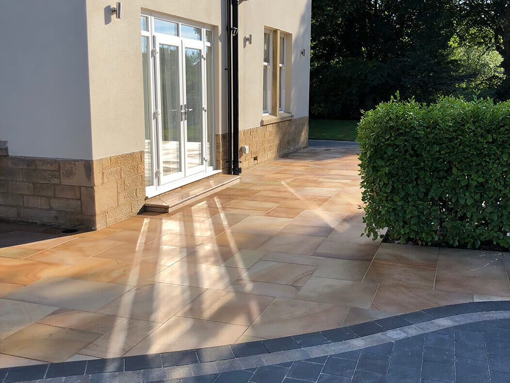 Double door view of Block Paving Indian Sandstone and driveway in Lancaster, Lancashire