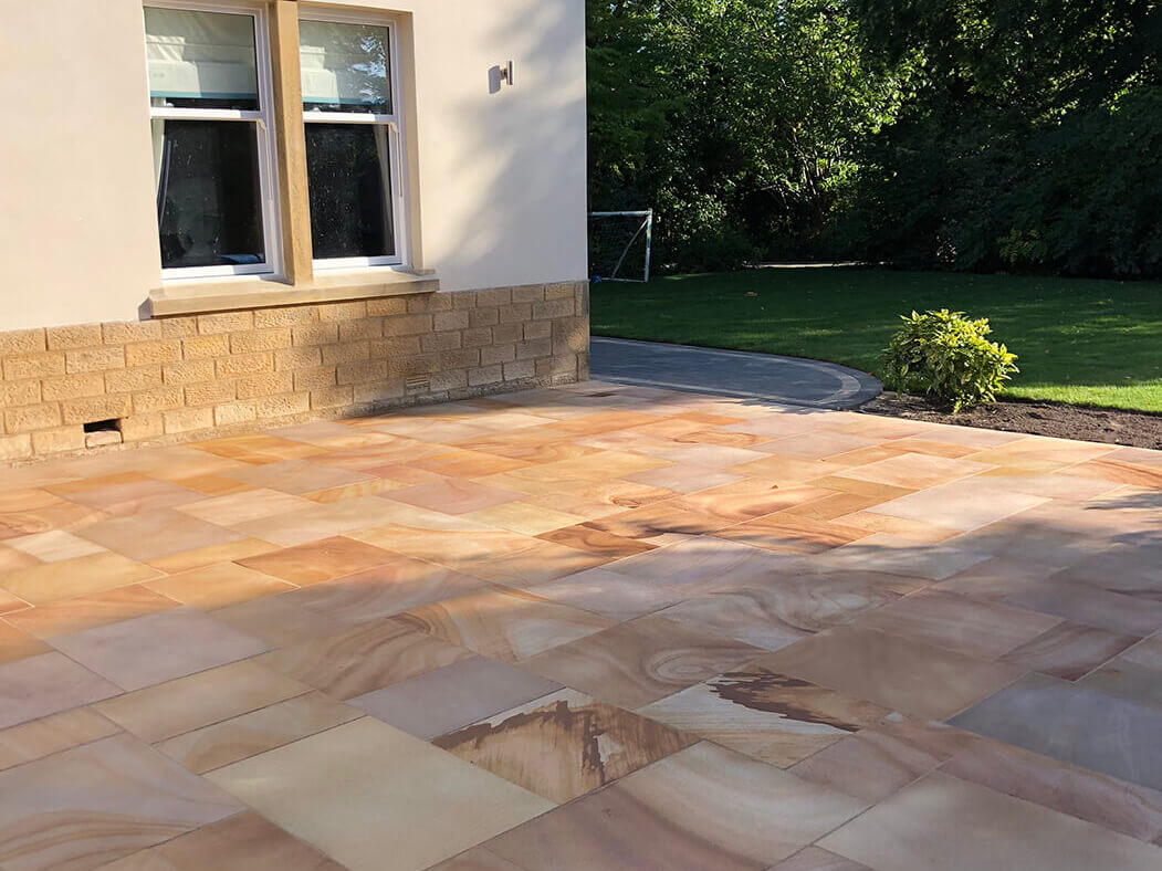 Window view of Indian Sandstone Block Paving Driveway job in Lancaster, Lancashire