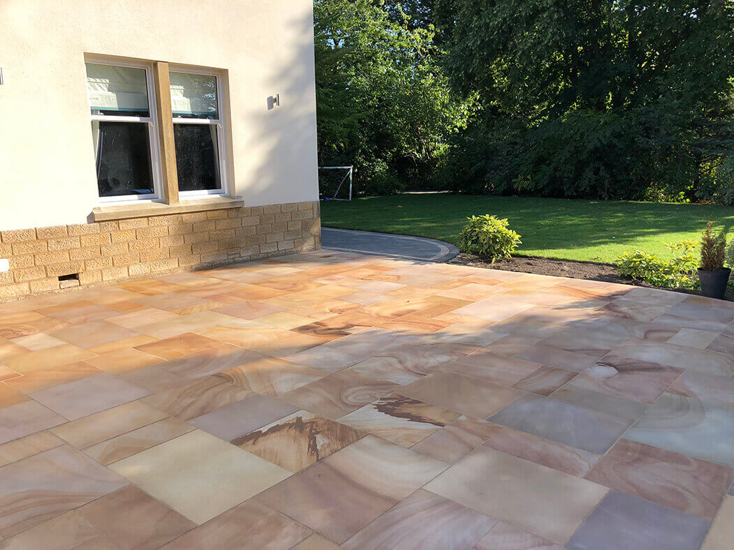 Wide window view of Indian Sandstone Block Paving Driveway job in Lancaster, Lancashire