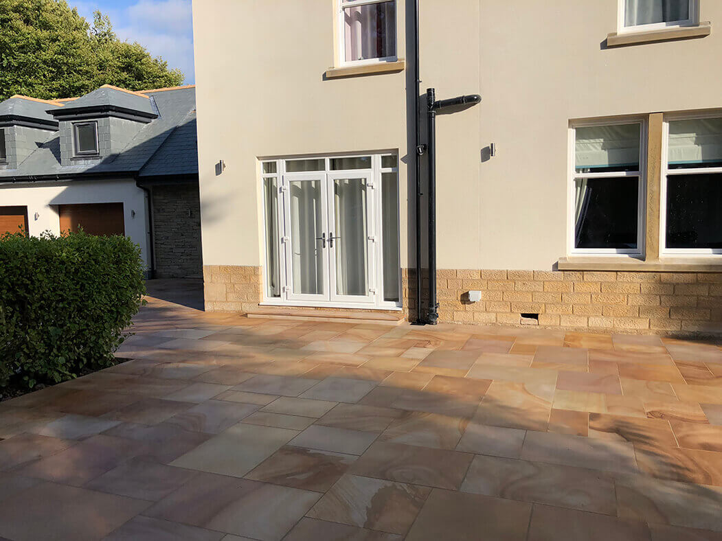 Back garden showing Block Paving Driveway and Indian Sandstone in Lancaster