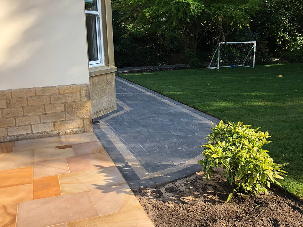Back garden showing Block Paving Driveway and Indian Sandstone in Lancaster, Lancashire