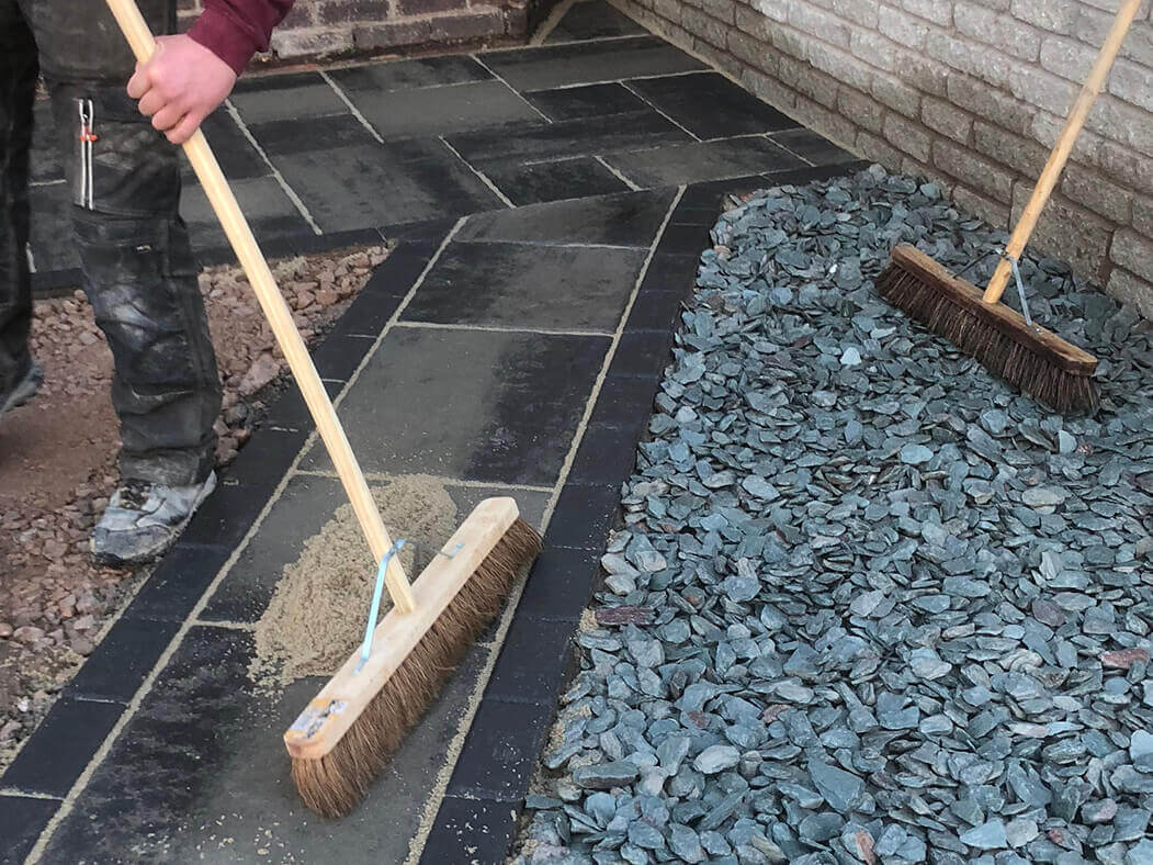 workers completing block paving on driveway in lancashire