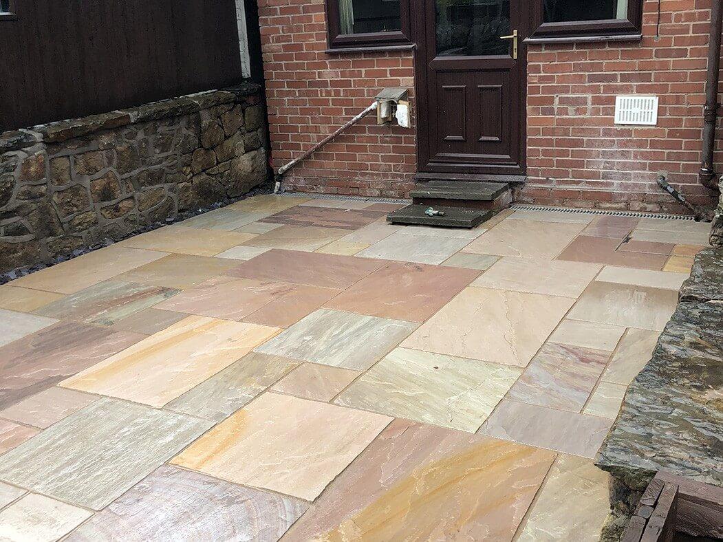 door view of bradstone indian sandstone patio in lancaster