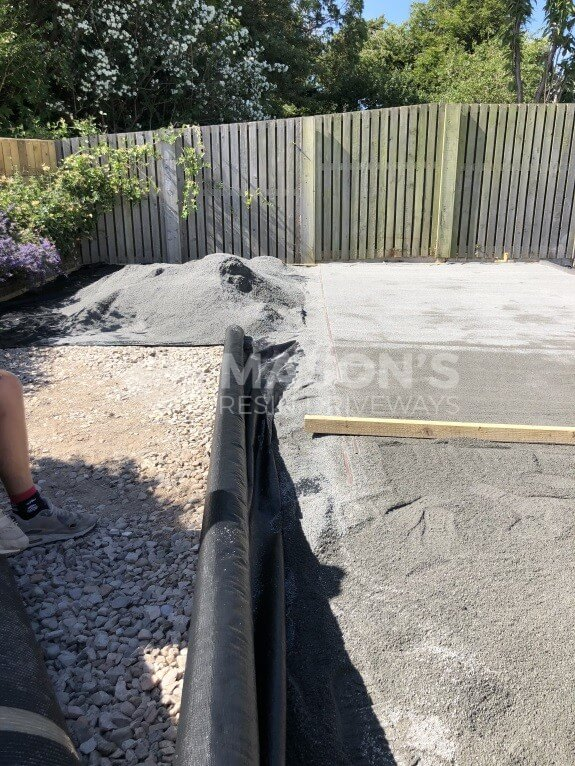 working on cobble pattern concrete driveway in lancashire
