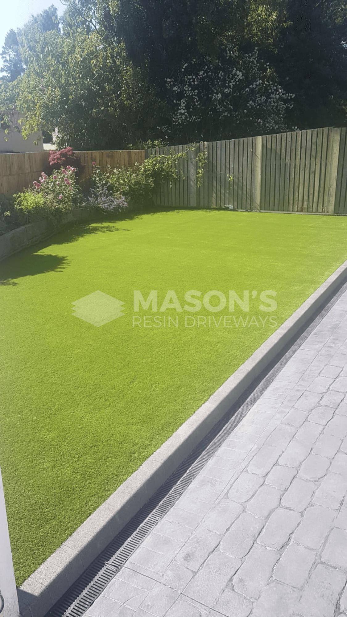 platinum cobble pattern concrete driveway with garden in lancashire