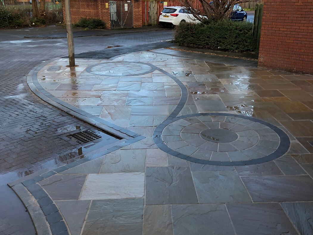 street view of framed indian sandstone driveway in Lancashire