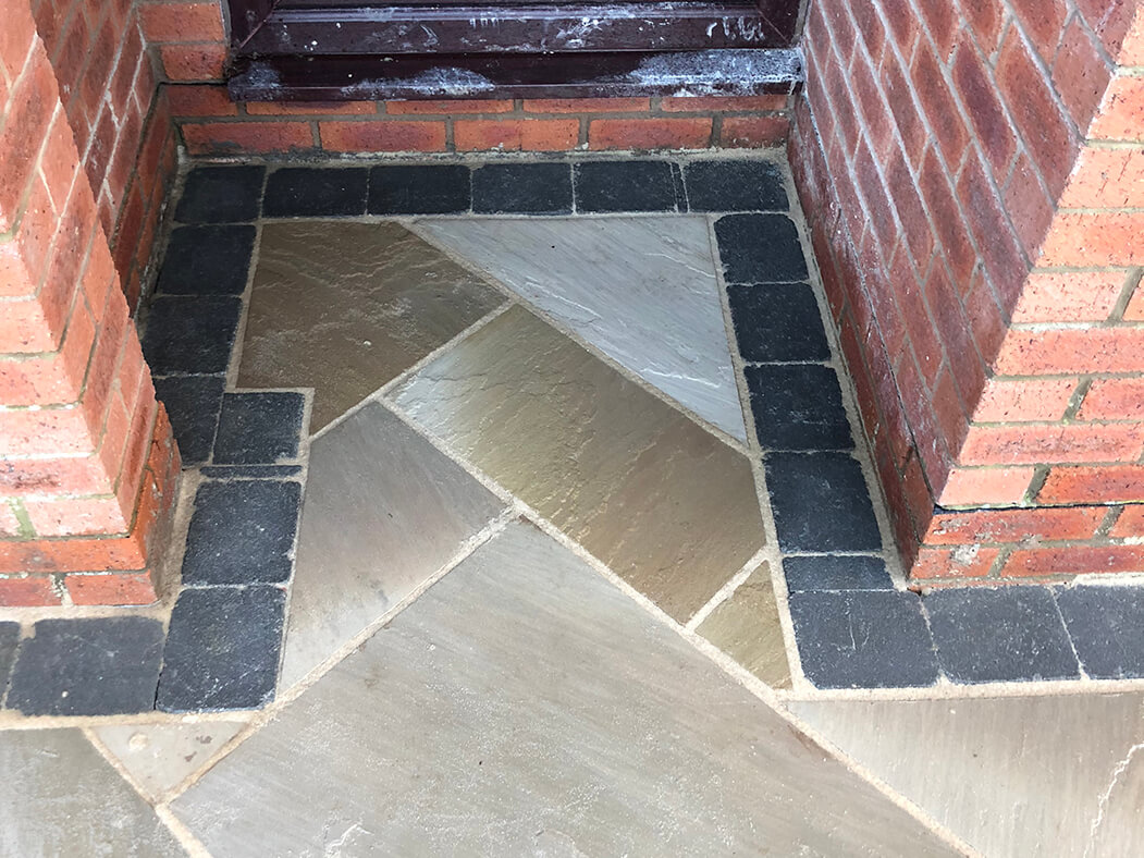 close up of corner in framed indian sandstone driveway, lancashire