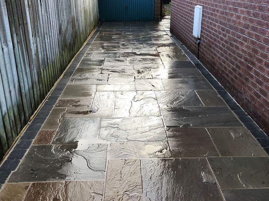 alley of indian sandstone flagged driveway in, lancashire