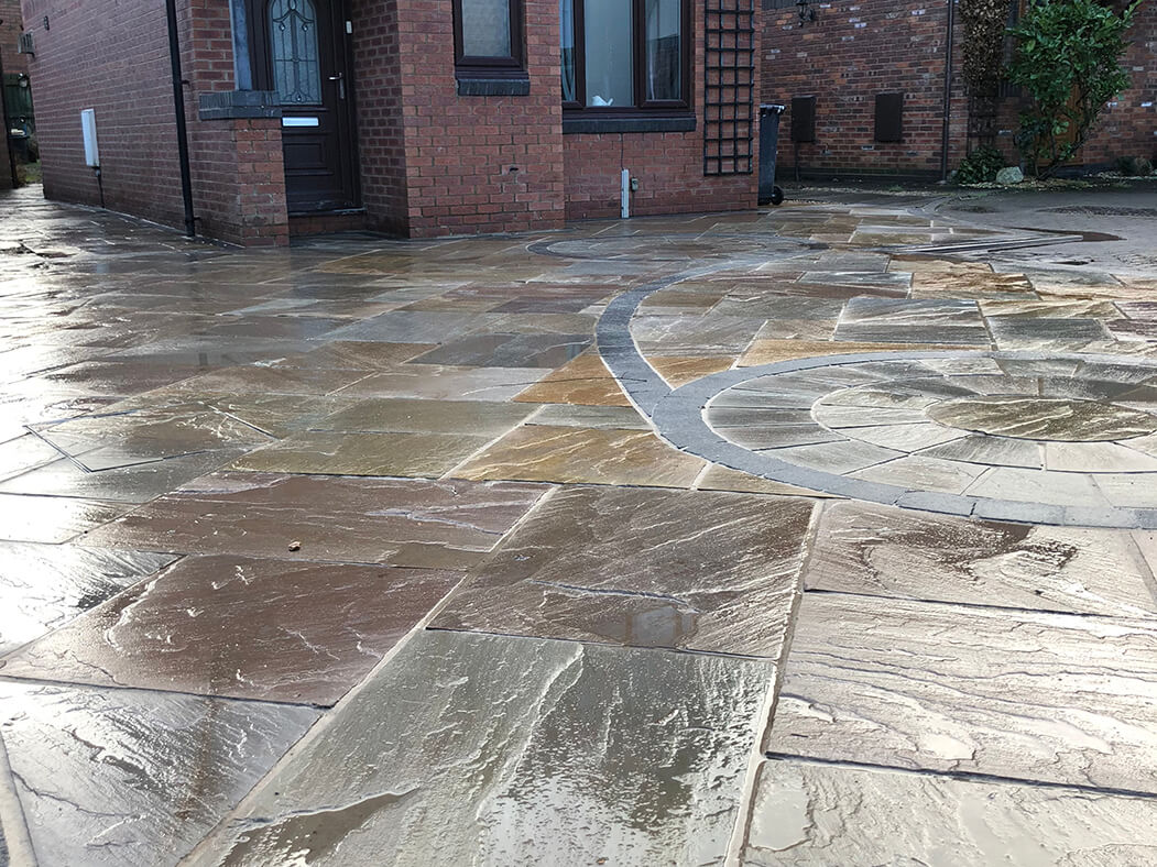 angles of indian sandstone framed driveway in, lancashire