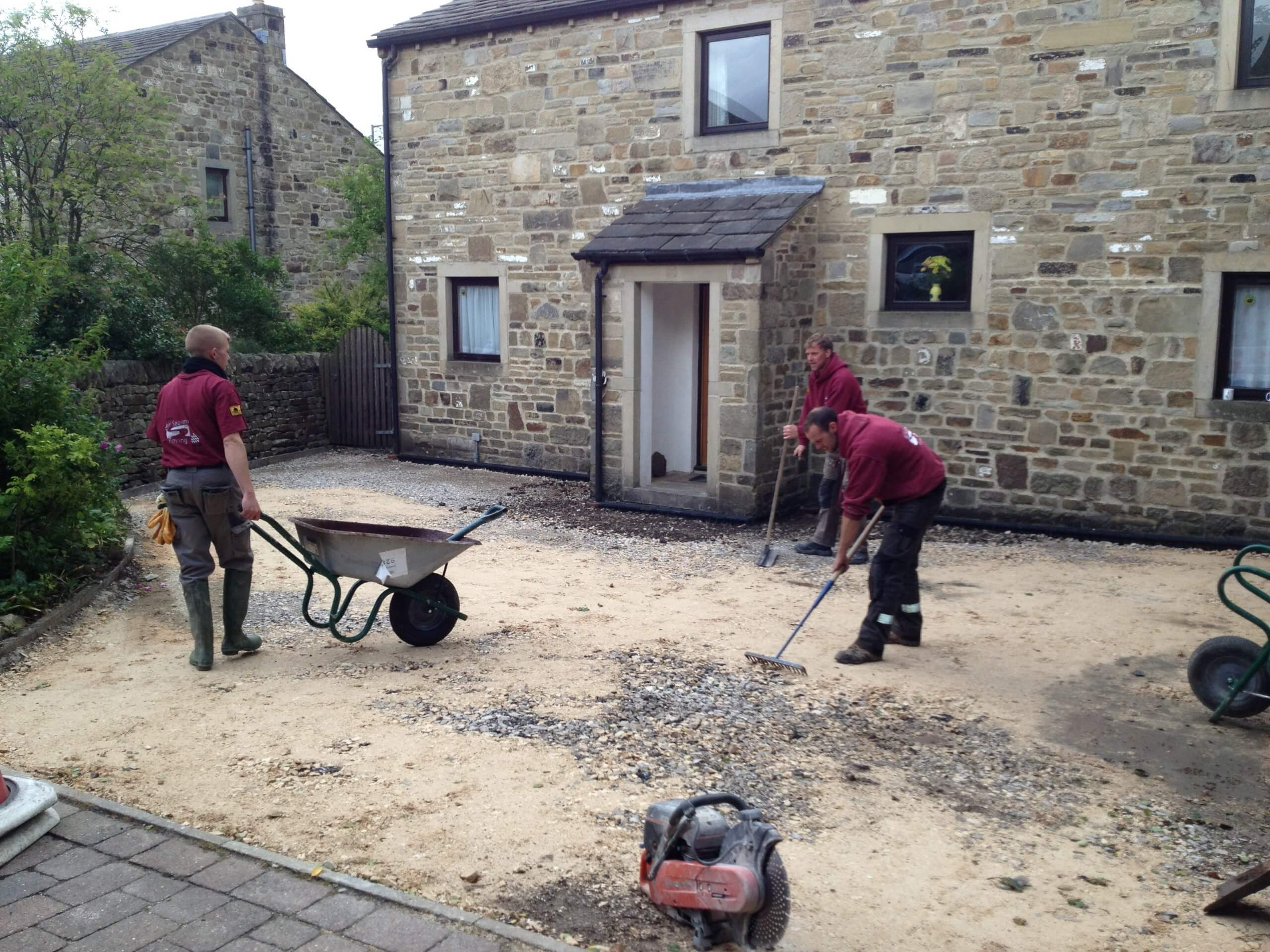 working on pattern imprinted concrete driveway near Lancashire