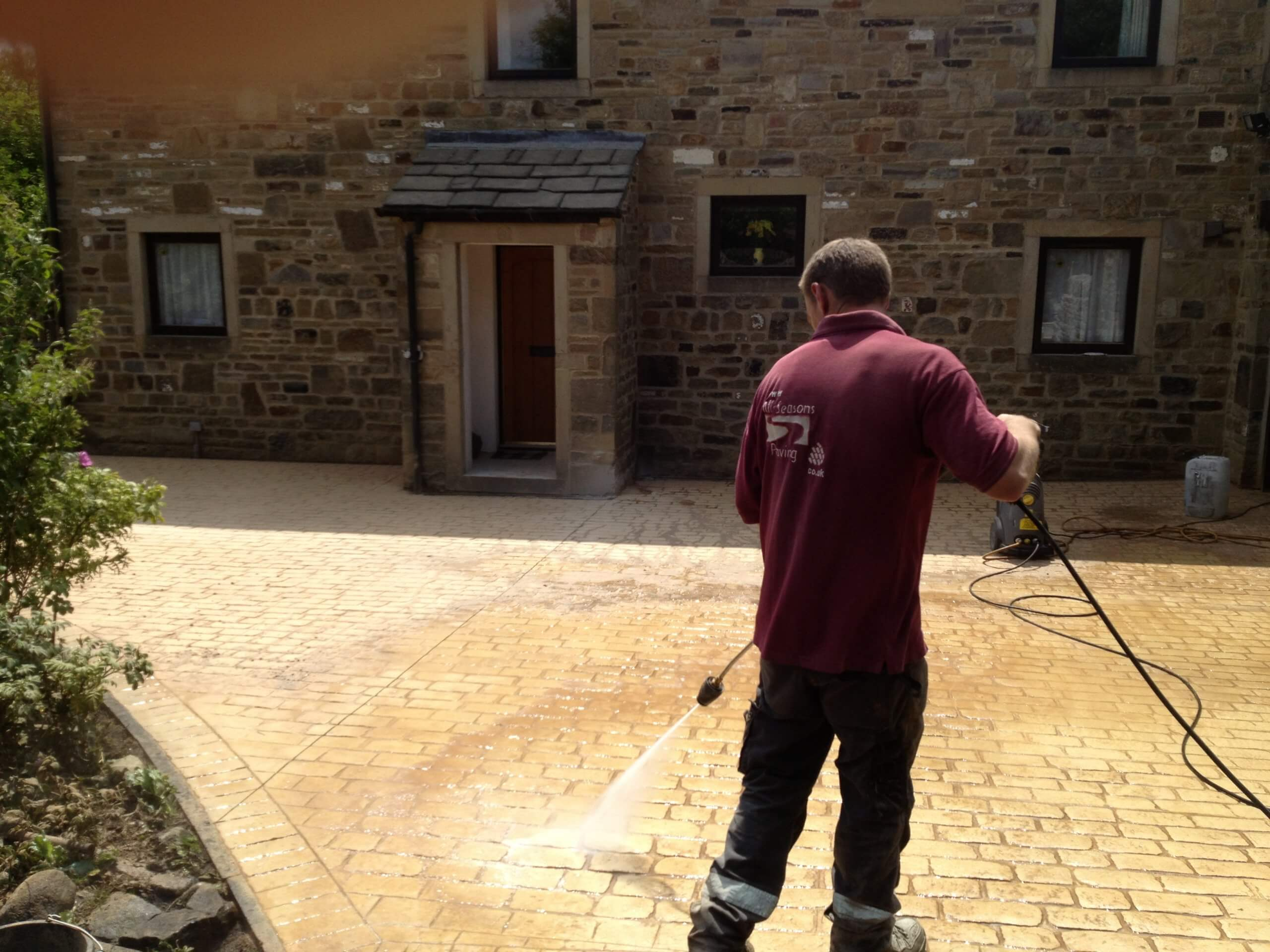 washing pattern imprinted concrete driveway near lancashire
