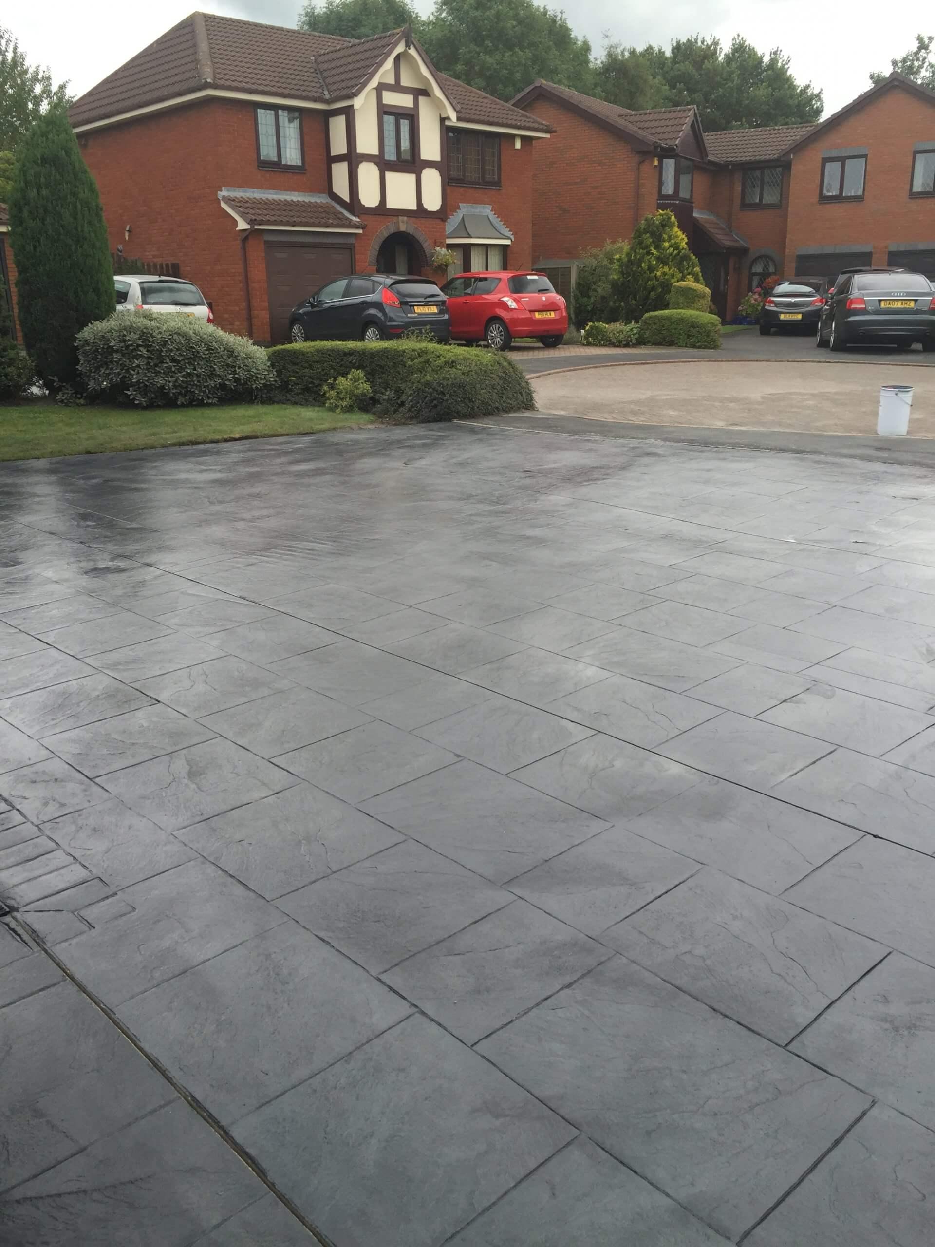 street view of pattern imprinted grey concrete driveway , lancashire