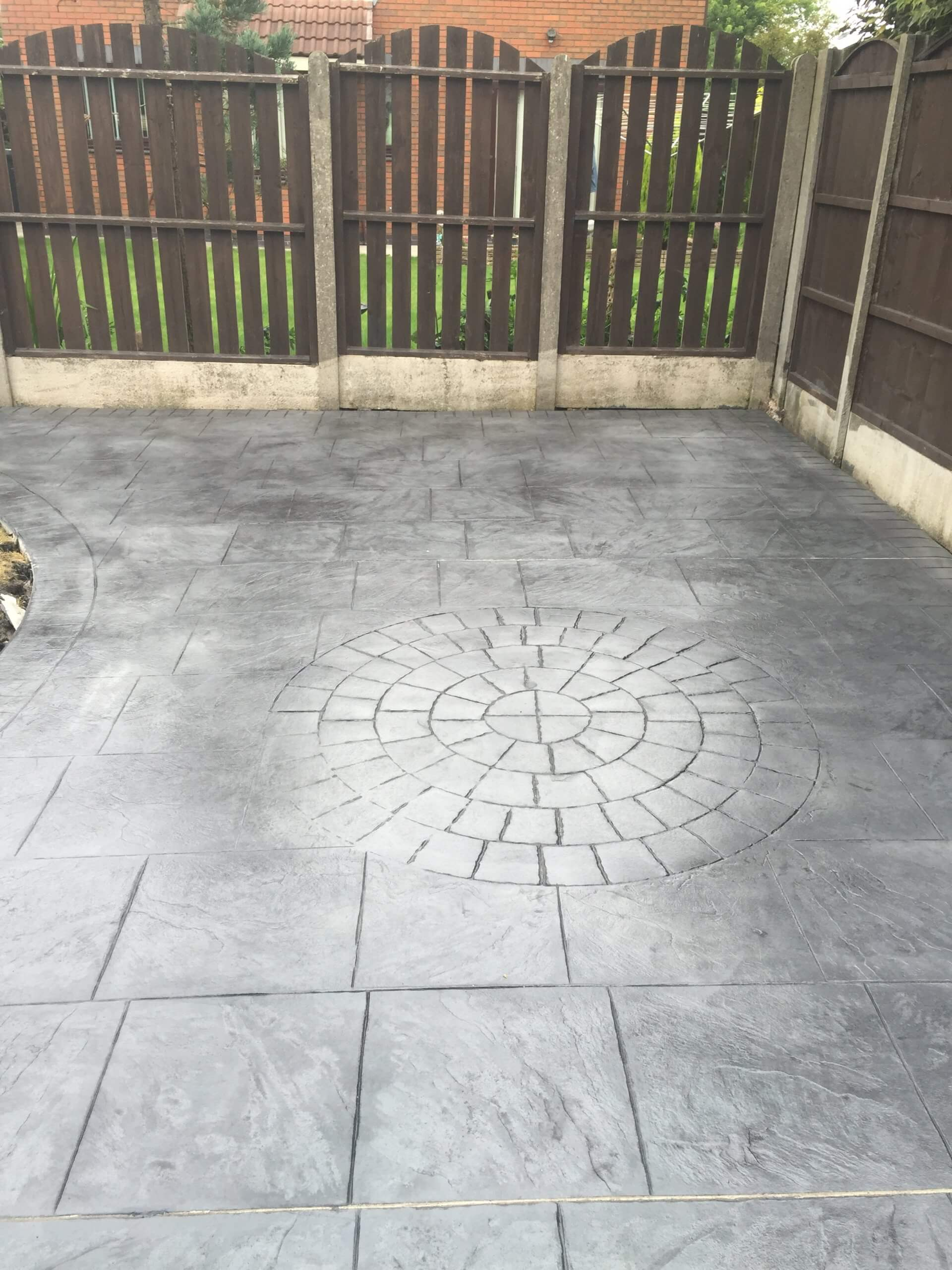circle centre in pattern imprinted concrete driveway & patio in Lancashire