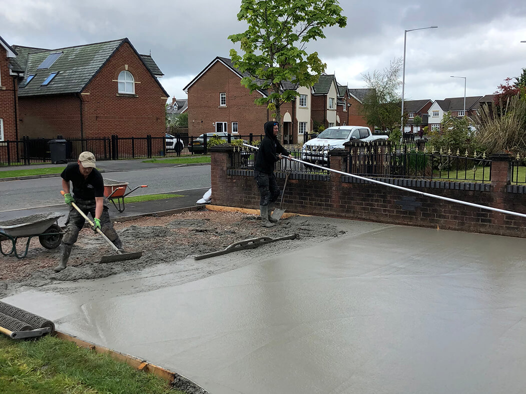 Workers in the process of the Pattern Imprinted Concrete Driveway in Morecambe
