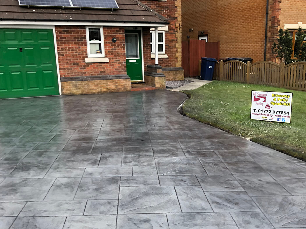 Finished Pattern Imprinted Concrete Driveway view showing our All Seasons Paving sign, Morecambe