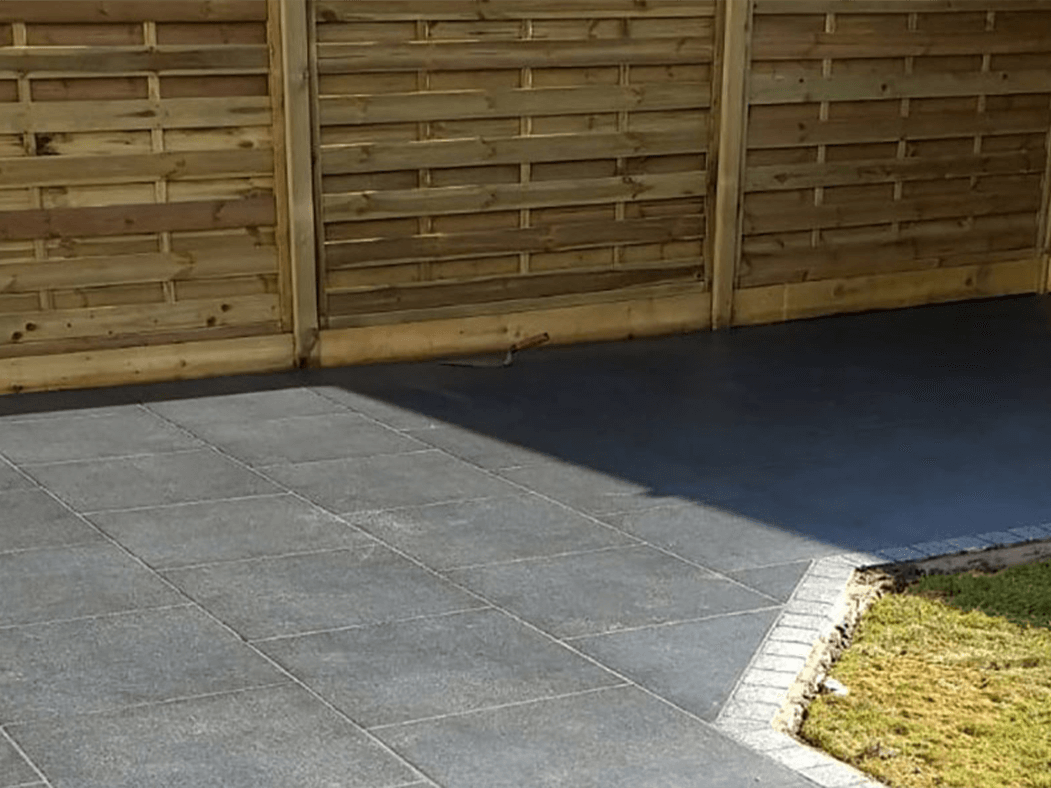 porcelain patio anthracite grey with tantalised fencing in lancashire