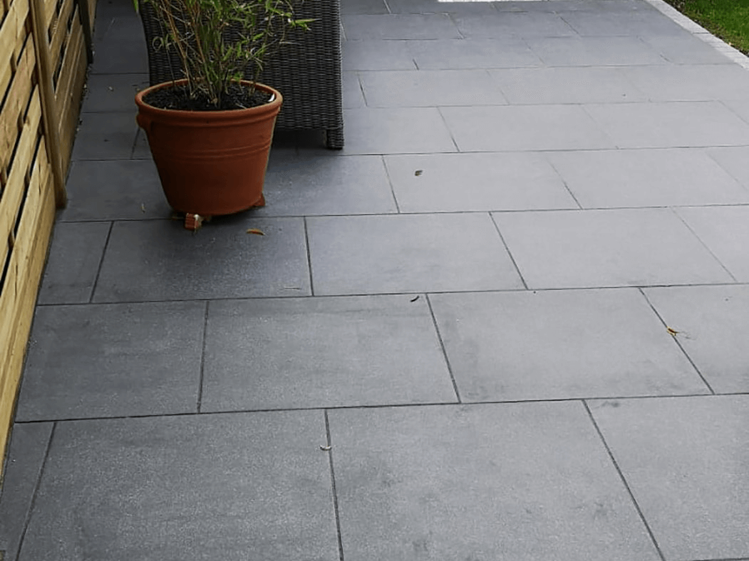 anthracite porcelain patio in lancashire, fencing view