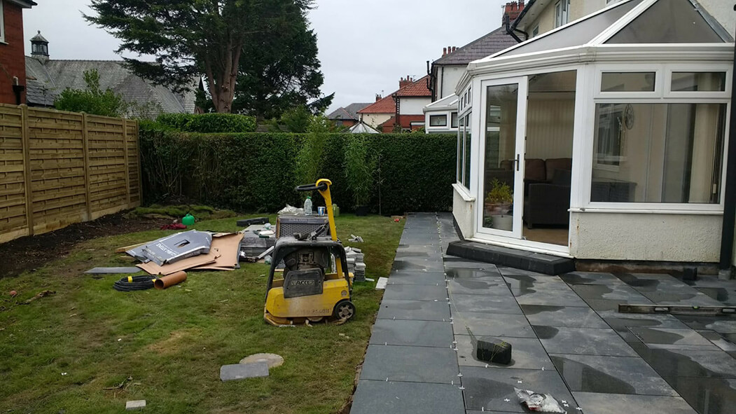 working on porcelain patio grey with tantalised fencing in lancashire
