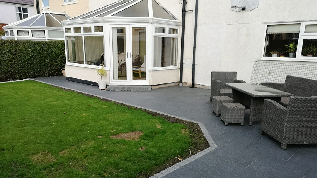 porcelain patio anthracite grey with tantalised fencing garden view in lancashire