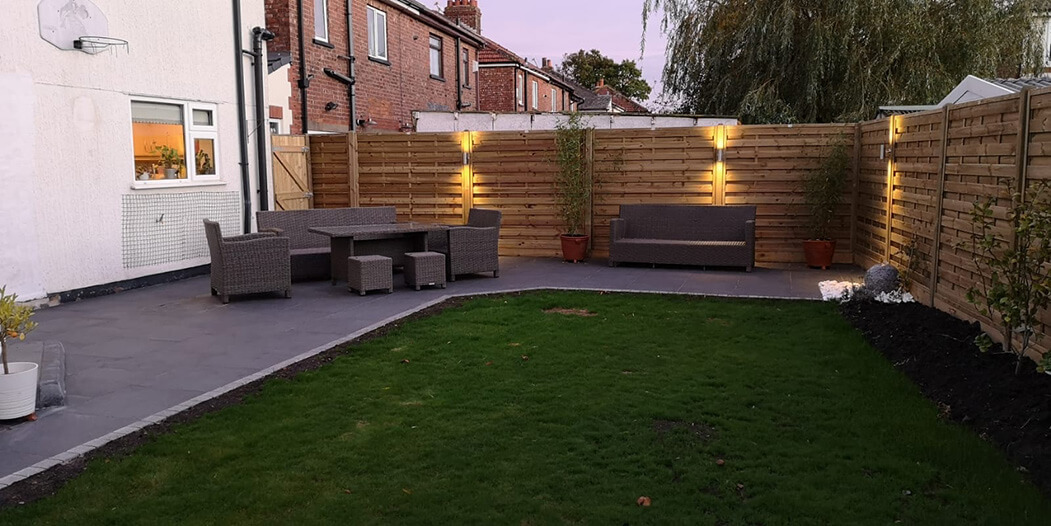 wide view of porcelain patio in lancashire with tantalised fencing