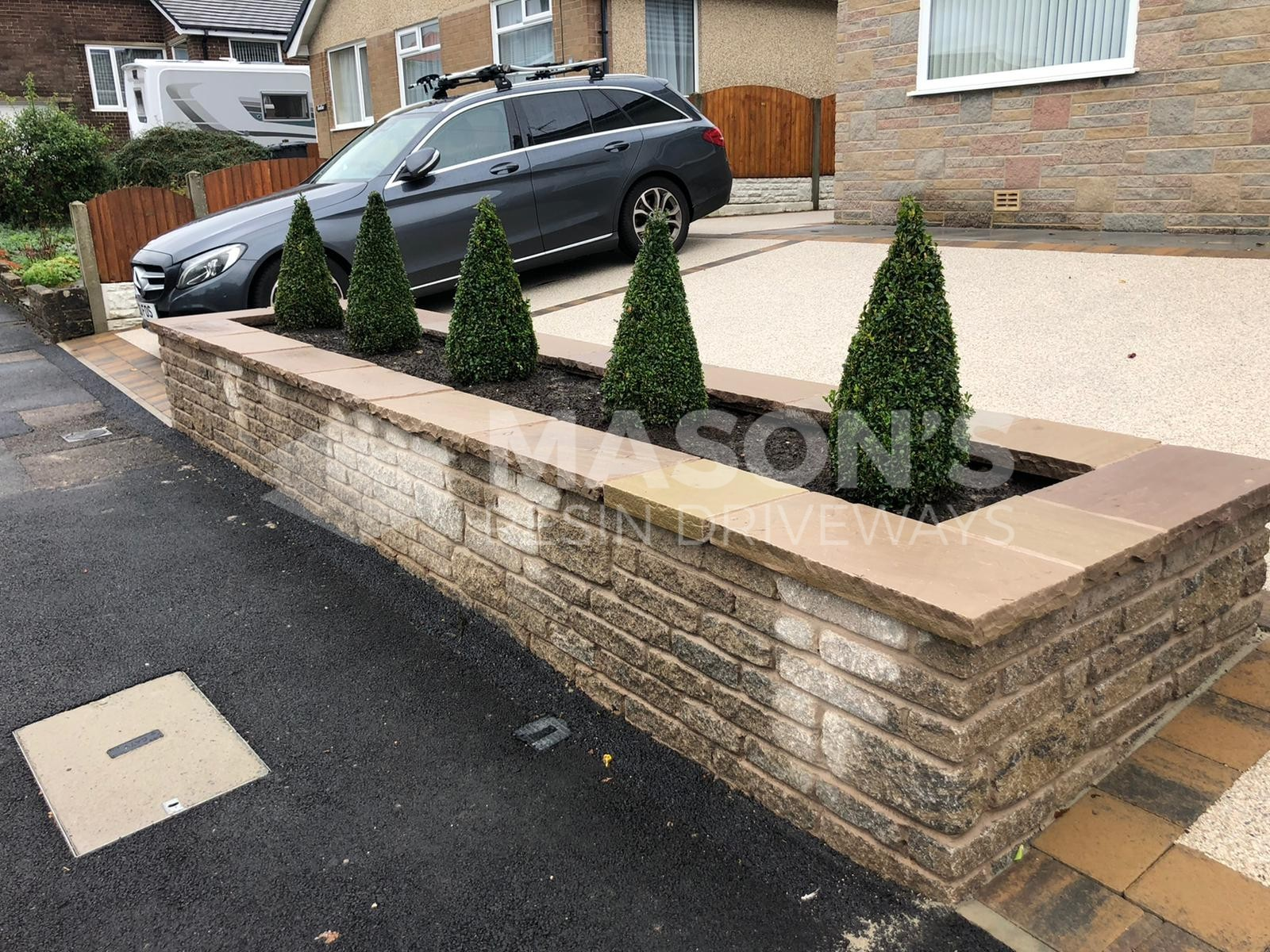 Resin bound driveway pearl quarts view of car and plants in Lancashire