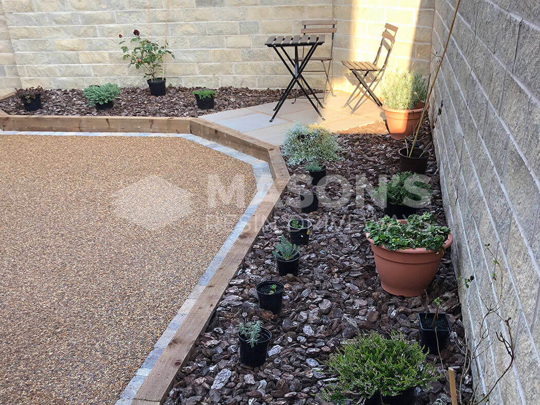 View of resin patio in Morecambe showing landscaped seating area.