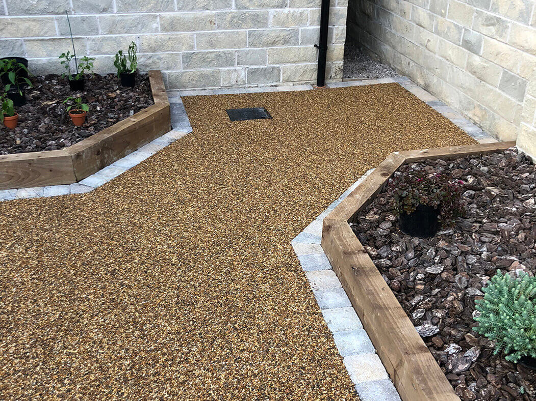 View of resin patio area near Morecambe in Lancashire showing drain access.