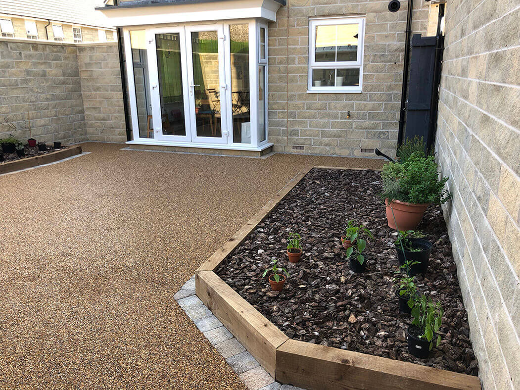 Resin Bound patio installed in Morecambe showing raised flower bed.