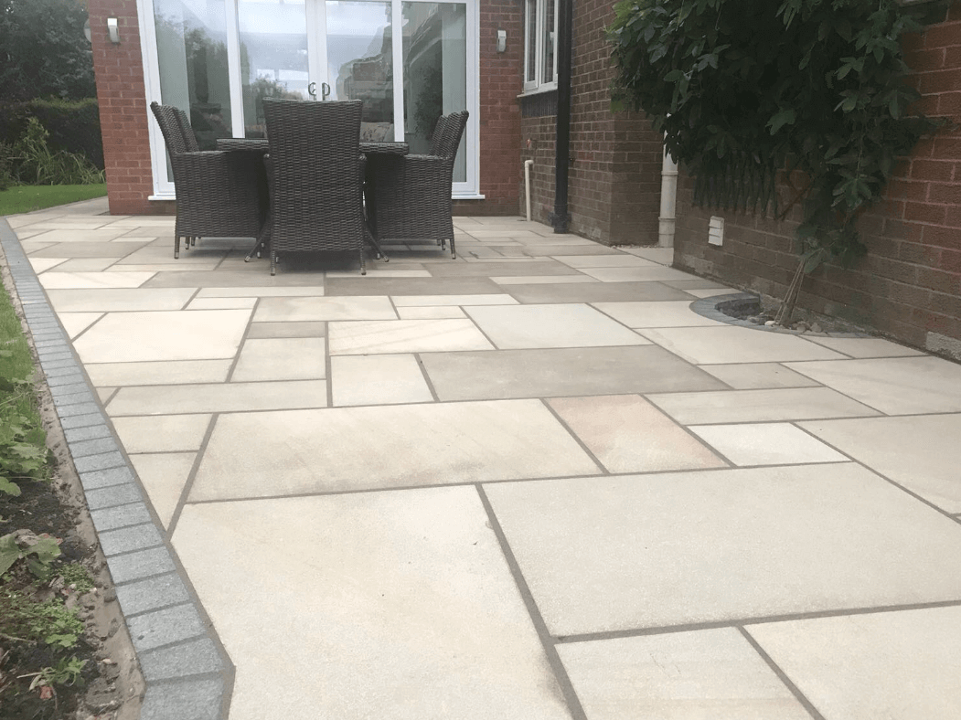 chair and table on sawn indian sandstone patio, lancaster