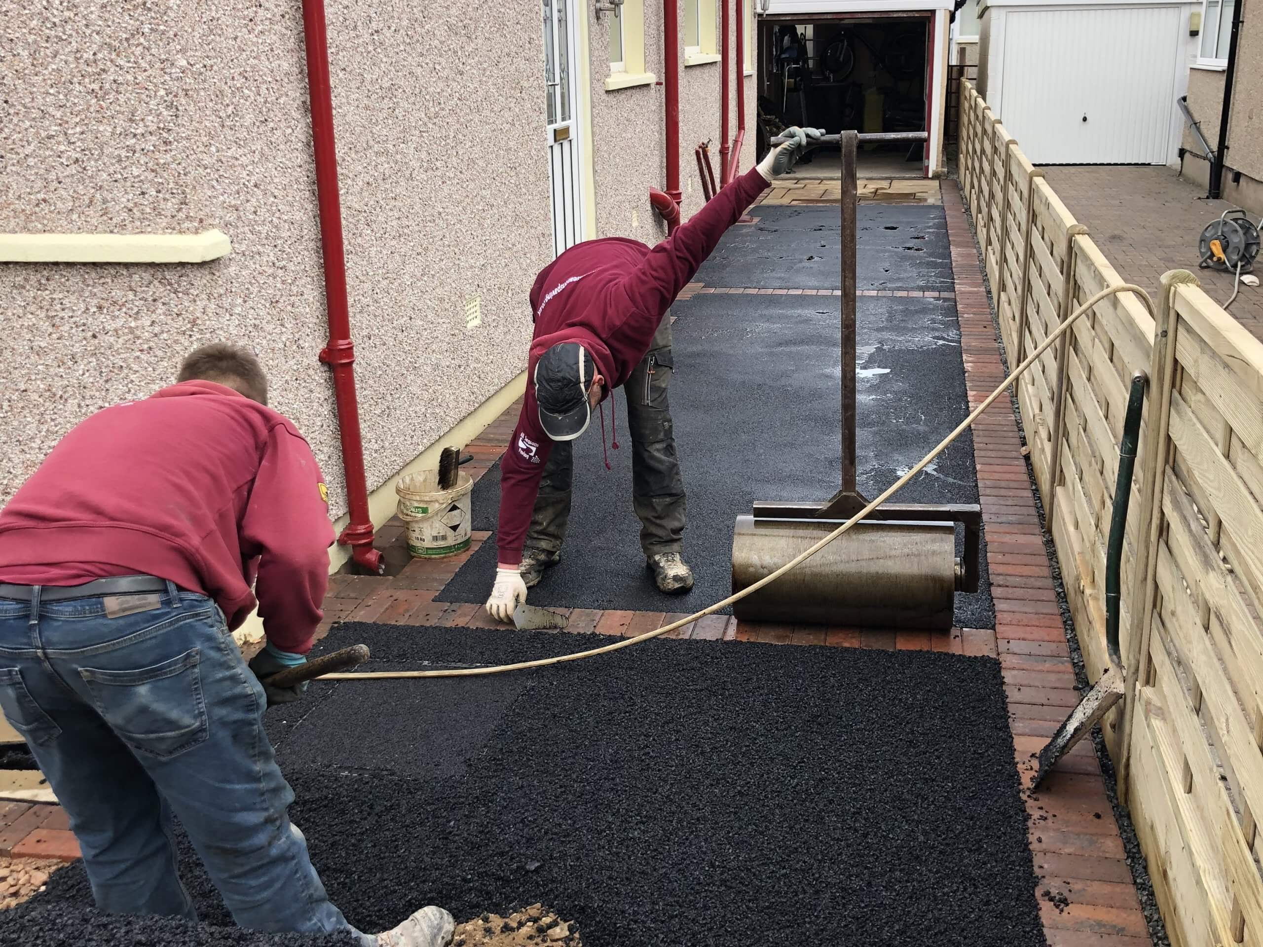 Workers on the Tarmac Driveway with Indian Sandstone in Lancaster, Lancashire