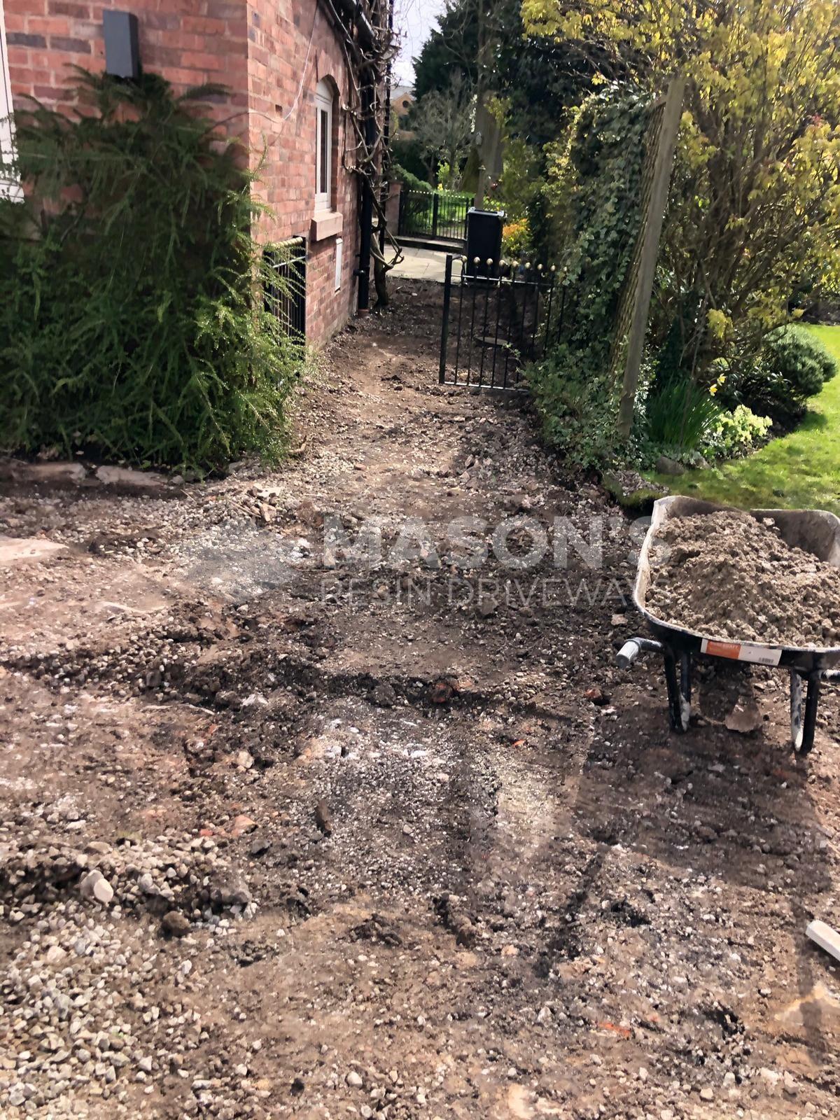 ground dug up for driveway installation