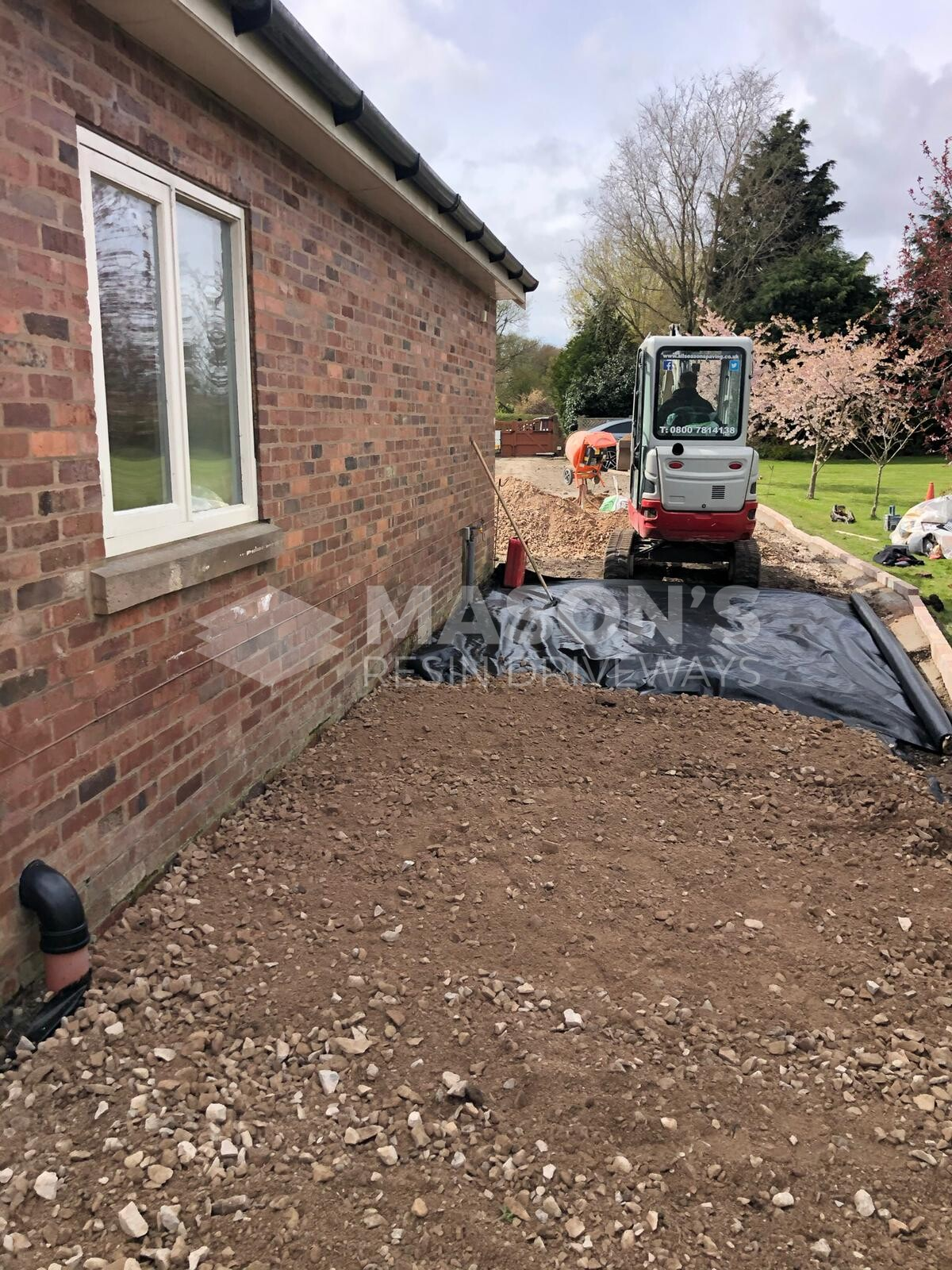 digger on driveway installation