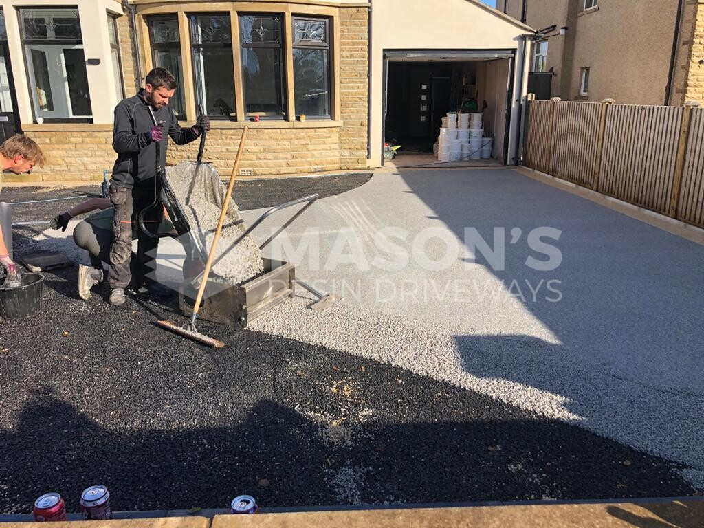 workers on resin bound driveway