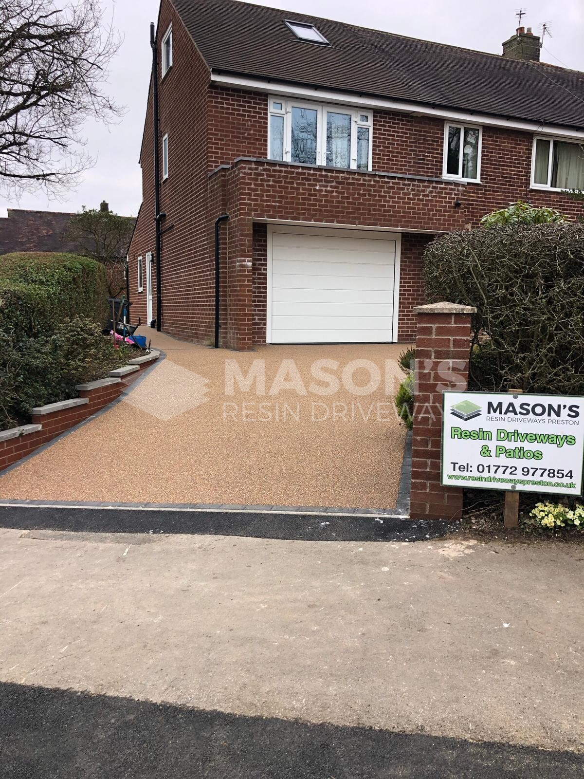 ASP sign with rose resin driveway