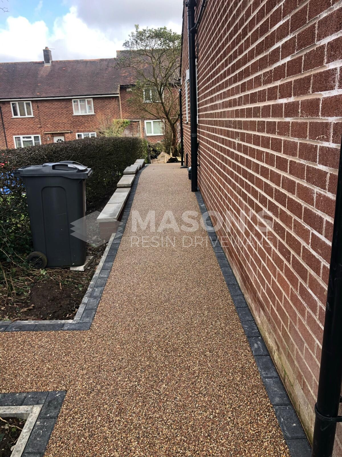 Rose resin pathway on house